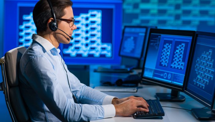 Call-center,Worker,Is,Speaking,With,The,Client,By,Headset.,Workplace