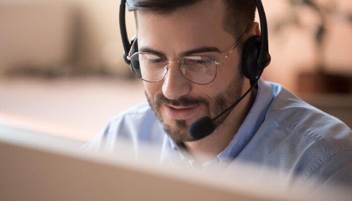 Focused,Businessman,Telemarketer,Telesales,Agent,Wear,Wireless,Headset,Make,Conference